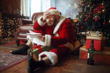 Bad Drunk Santa Claus Reads Le...