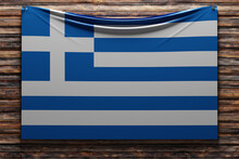 3D Illustration Of The National   Fabric Flag Of Greece  Nailed On A Wooden Wall .Country Symbol.