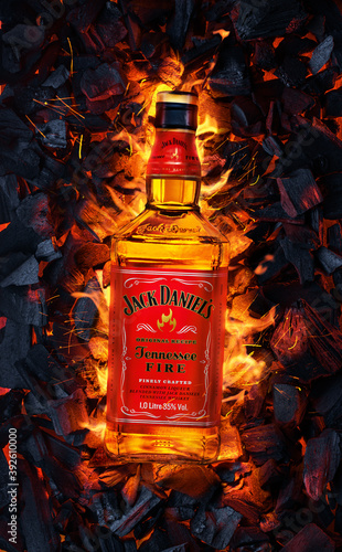 Ukraine, Kiev. November 12, 2020. Bottle of Jack Daniels Whiskey Tennessee Fire top view in burning coals.