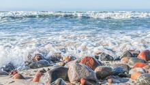 Sea Foam On Wet Pebbles On The...
