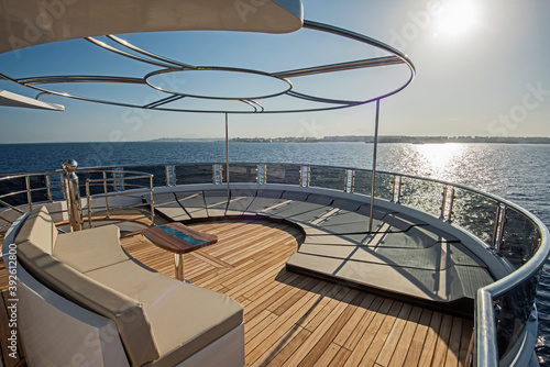 Fotografering Table and chairs on deck of a luxury motor yacht