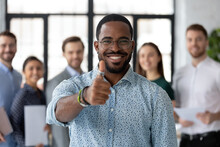 Best Ever. Portrait Of Loyal Excited Black Male Client Customer Demonstrating Thumb Up Sign Recommending Good Product Service, Happy African Employee Looking At Camera Glad To Work In Company Staff