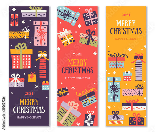 Christmas and New Year 2021 vertical banners set, border with colorful ornate gift boxes and snow confetti. Vector illustration. Place for text. Party brochure template
