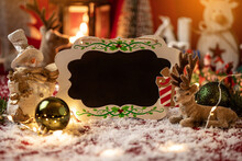 Christmas Bord With Copy Space Surrounded With Christmas Decorations