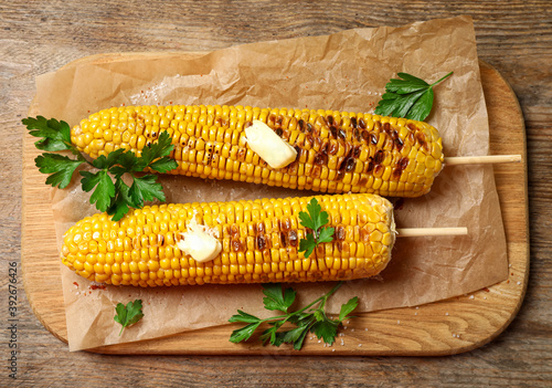 Tasty grilled corn on wooden table, top view Canvas