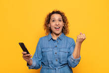 Hispanic Middle Age Woman Feeling Shocked, Excited And Happy, Laughing And Celebrating Success, Saying Wow!