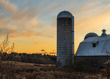 Evening Sun Lights Up Farm Sil...
