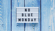 Blue Monday Day Banner Concept. White Board With Text No Blue Monday On Blue Wooden Background, Top View, Flat Lay.