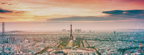Obraz aerial view over Paris at sunset with iconic Eiffel tower - fototapety do salonu