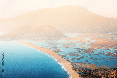 Scenic aerial paniramic view from mountain Bozburun to Iztuzu beach and the Dalyan river Delta as well as lake Sulungur at sunset time Fotobehang