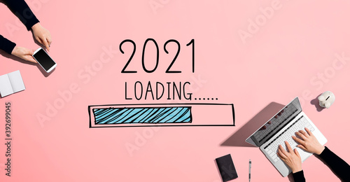 Obraz Loading new year 2021 with people working together with laptop and phone - fototapety do salonu