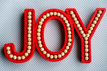 Red Joy Word Letters On A Gray...