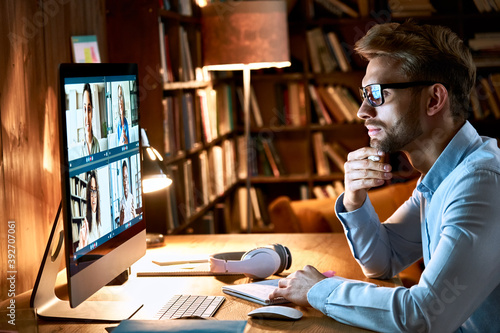 Business man meeting virtual team on video conference call using computer. Social distance worker working from home office in remote videoconference online chat, watching webinar, making videocall.