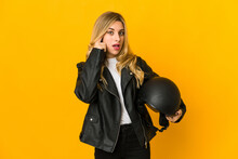 Young Blonde Caucasian Biker Woman Holding Helmet Showing A Disappointment Gesture With Forefinger.