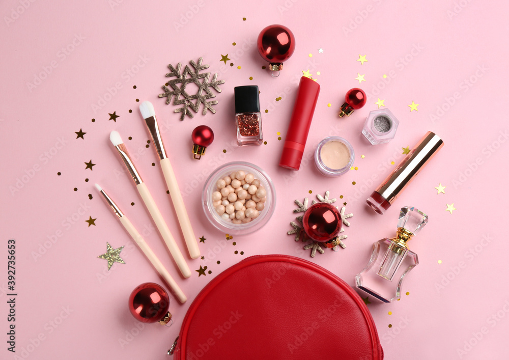 Fototapeta Flat lay composition with decorative cosmetic products on pink background. Winter care