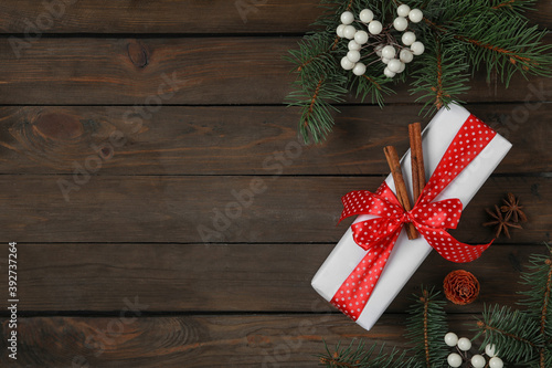 Flat lay composition with white Christmas gift box on wooden table Fotobehang