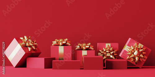 Fototapeta Minimal product background for Christmas, New year and sale event concept. Red gift box with golden ribbon bow on red background. 3d render illustration. Clipping path of each element included. obraz