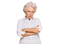 Senior Grey-haired Woman Wearing Casual Clothes Skeptic And Nervous, Disapproving Expression On Face With Crossed Arms. Negative Person.