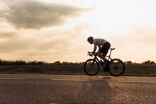 Cyclist In Helmet Enjoying Fav...