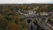 Drone Shot Above Knaresborough Viaduct While Train Passes On It, In A Beautiful Autumn Day.