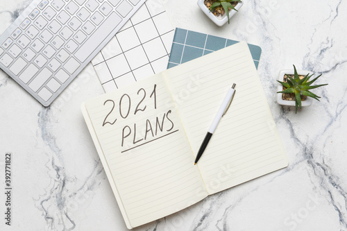Obraz na plátně To do list on 2021 year with computer on white background