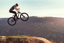 Young Man Flying Through The Air On A Mountain Bike