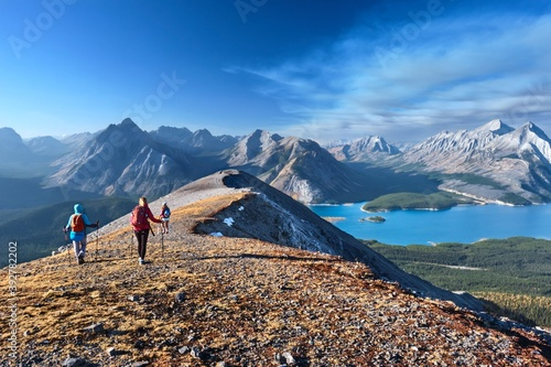 Papel de parede Women hikers walking on beautiful ridge with lake view in Canadian Rockies