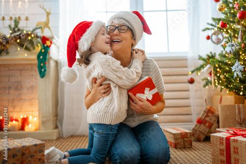 Fotografia, Obraz family celebrating Christmas