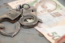 Handcuffs Lie On A 500 Hryvnia...