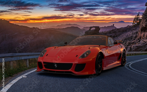 Sporty Ferrari 599 on a beautiful road at sunset Canvas Print