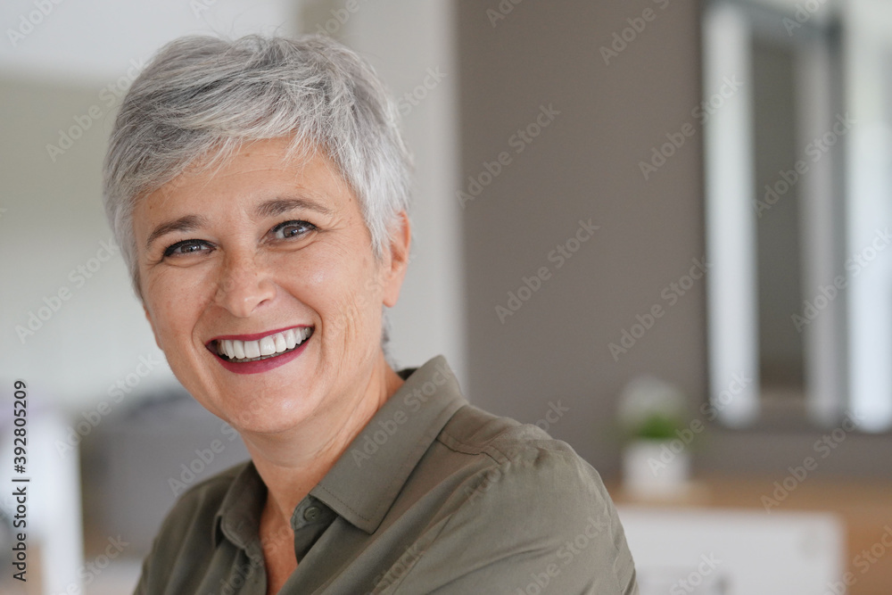 Fototapeta Portrait of a attractive mature woman with white hair