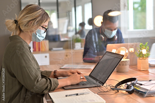 Obraz Multiracial staff at work in cowork office - Young people wearing surgical mask for coronavirus - fototapety do salonu