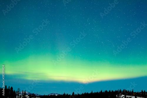 Fotografiet Northern Lights Aurora borealis winter landscape
