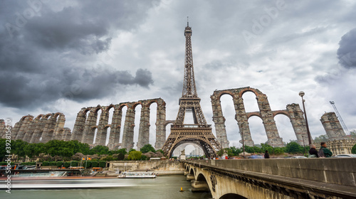 Fototapeta Photo montage of Eiffel tower and antique roman aqueduct