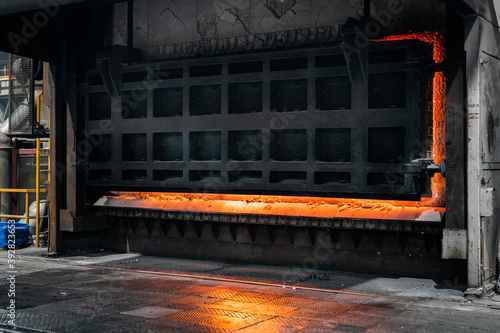 Canvastavla Big industrial furnace glowing red hot while heating and melting some scrap meta