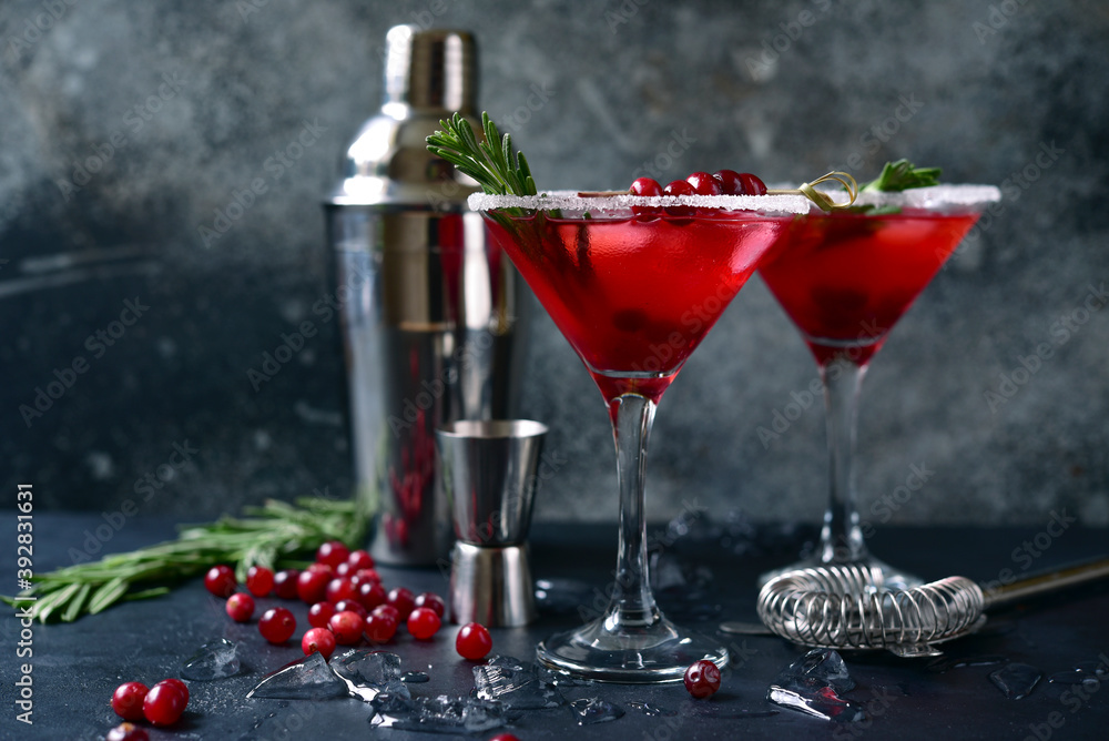 Fototapeta Christmas cranberry cocktail with rosemary.