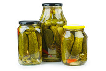 Three Glass Jars With Pickled Cucumbers