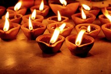 Flickering Earthen Lamps With ...