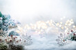 canvas print picture - Christmas white decorations on snow with fir tree branches and christmas lights. Winter Decoration Background