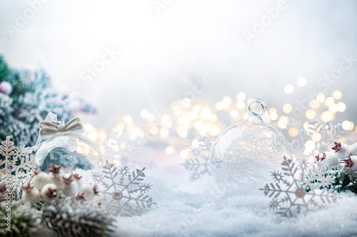 Christmas white decorations on snow with fir tree branches and christmas lights Fototapeta