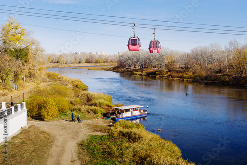 Fotografija Ural river, Orenburg, Russia - October, 18, 2020: Cable car and pleasure boat ne