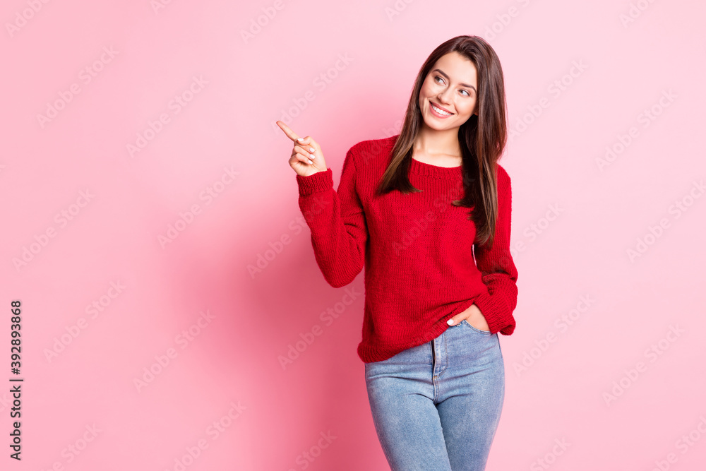 Fototapeta Photo of lovely girl hand pocket indicate forefinger look empty space wear red sweater jeans isolated pink color background