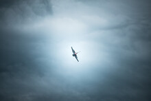 Fighting Jet F-16 In The Cloudy Sky Ready To Disappear Into The Horizon.