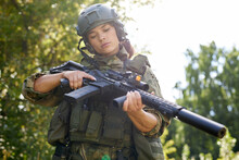 Military Woman Is Checking Details Of Weapon Before Military Training Loading Gun Outdoors, Sport Shooting