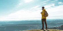 Hiker Man On The Top Of The Mountain Looking The Landscape View - Success, Motivational And Sport Concept