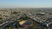Aerial Approach To Bull Fighting Stadium In Guadalajara, Mexico. Plaza De Toros Nuevo Progreso