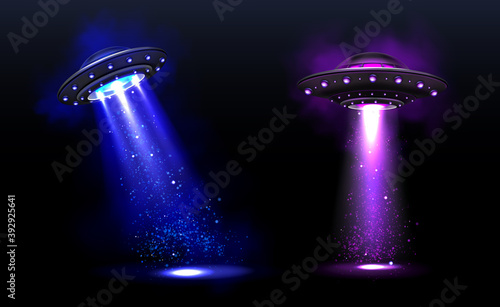 Fotografering 3d UFO, vector alien space ships with blue and purple light beams with sparkles