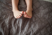 Toddler Feet With Toes Touchin...