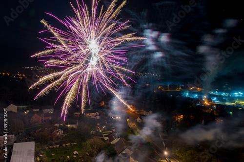 Aerial view of fireworks over south wales houses on bonfire night, United Kingdo Fototapeta