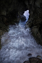 Pacific Waves Crash Through A Sea Cave At Leo Carillo State Park